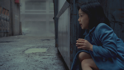 Mako Mori as a child, hiding from a Kaiju, in Pacific Rim (2013).  Image courtesy of imageshack.us