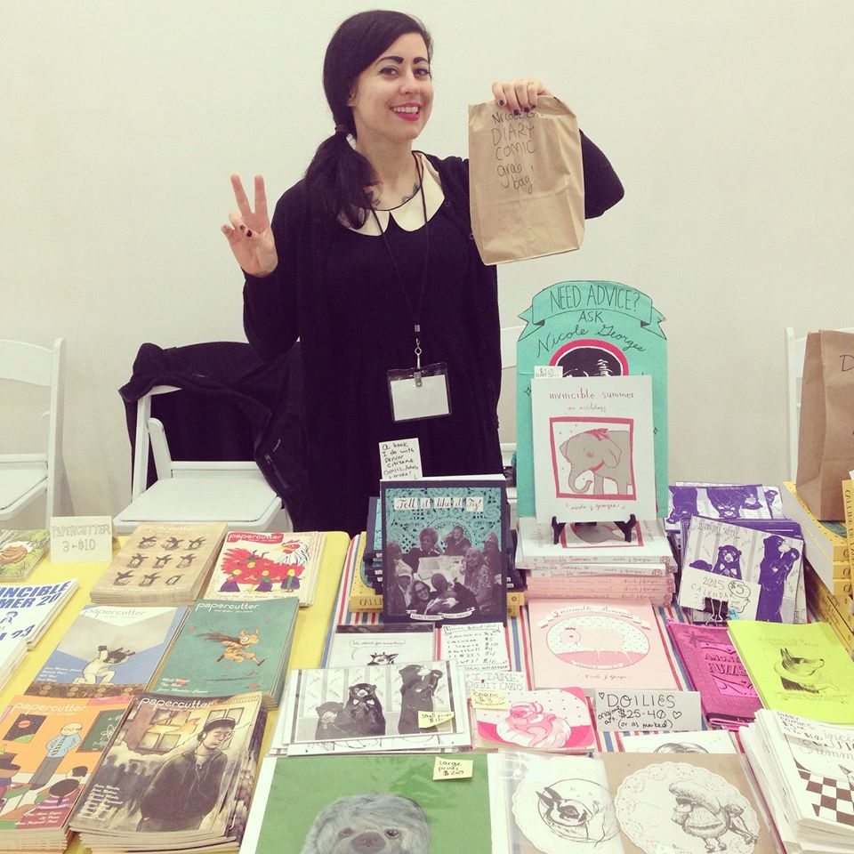 Nicole with her work at MoCCA in New York City