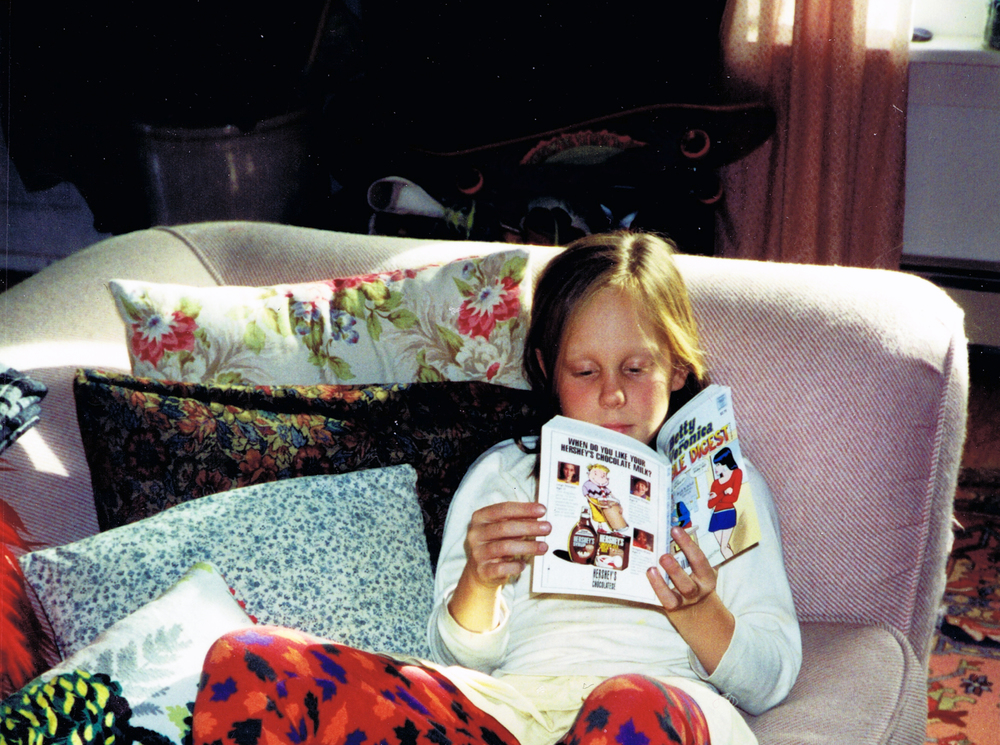 Lucy reading as a child.